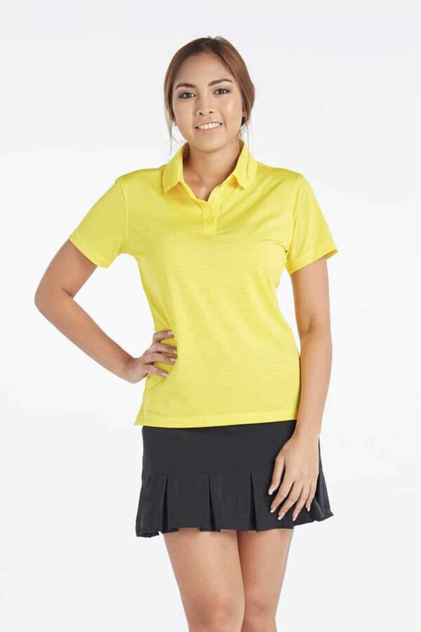 A female model modelling Fenix Xcell Ladies Short Sleeve Golf Polo Shirt of yellow colour