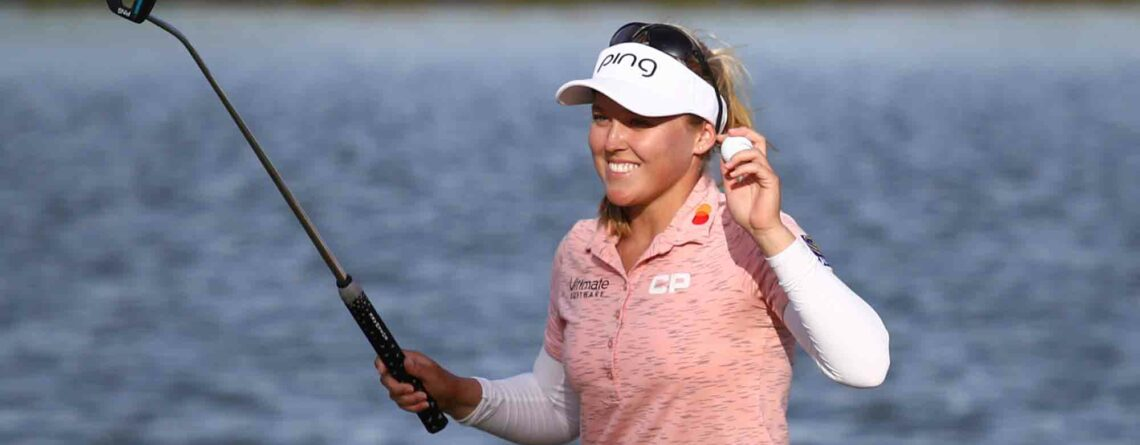 Henderson celebrates holing a putt during Golf TV broadcast