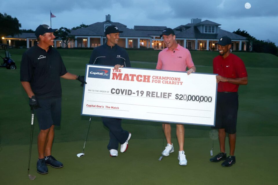 Woods wins charity golf match wit Tom Brady