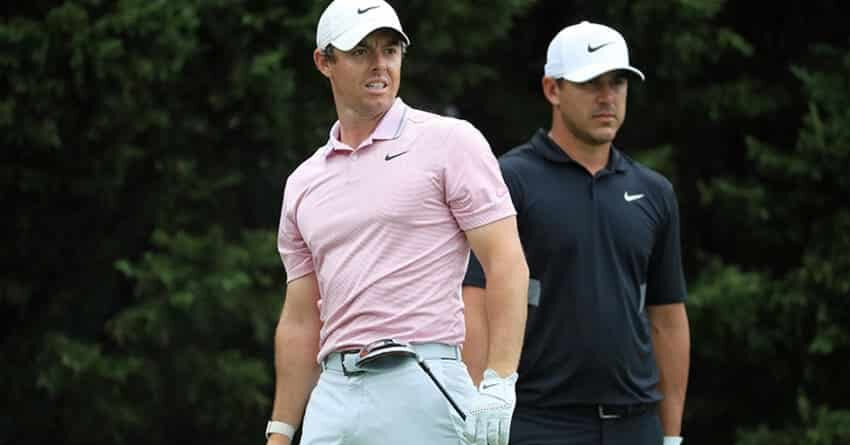 The first golf tournament post covid-19 features Rory McIlroy and John Rahm pictured together in pink and black golf polo shirt respectively