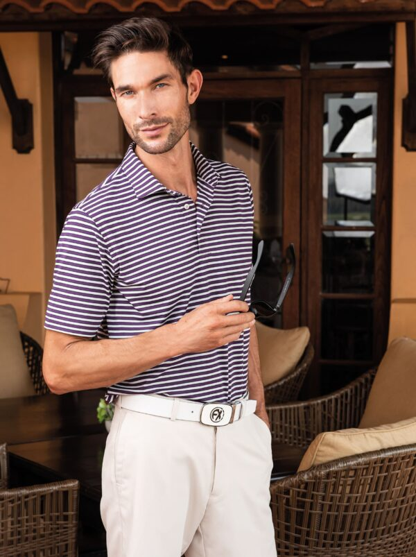 Model posing in purple and white cross striped Fenix XCell PE polo shirt