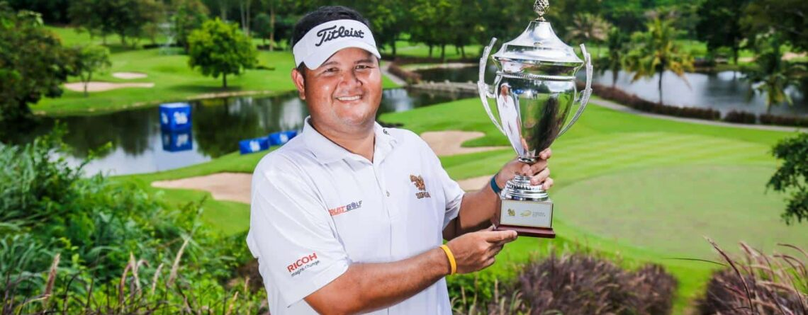 Prom Meesawat holding trophy after win on All Thailand Golf Tour