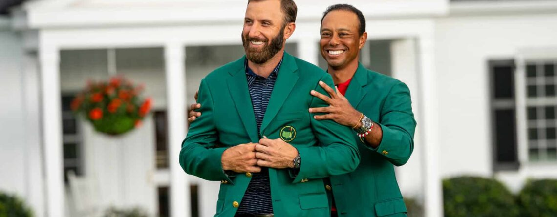 Tiger Woods putting the Green Jacket on Dustin Johnson