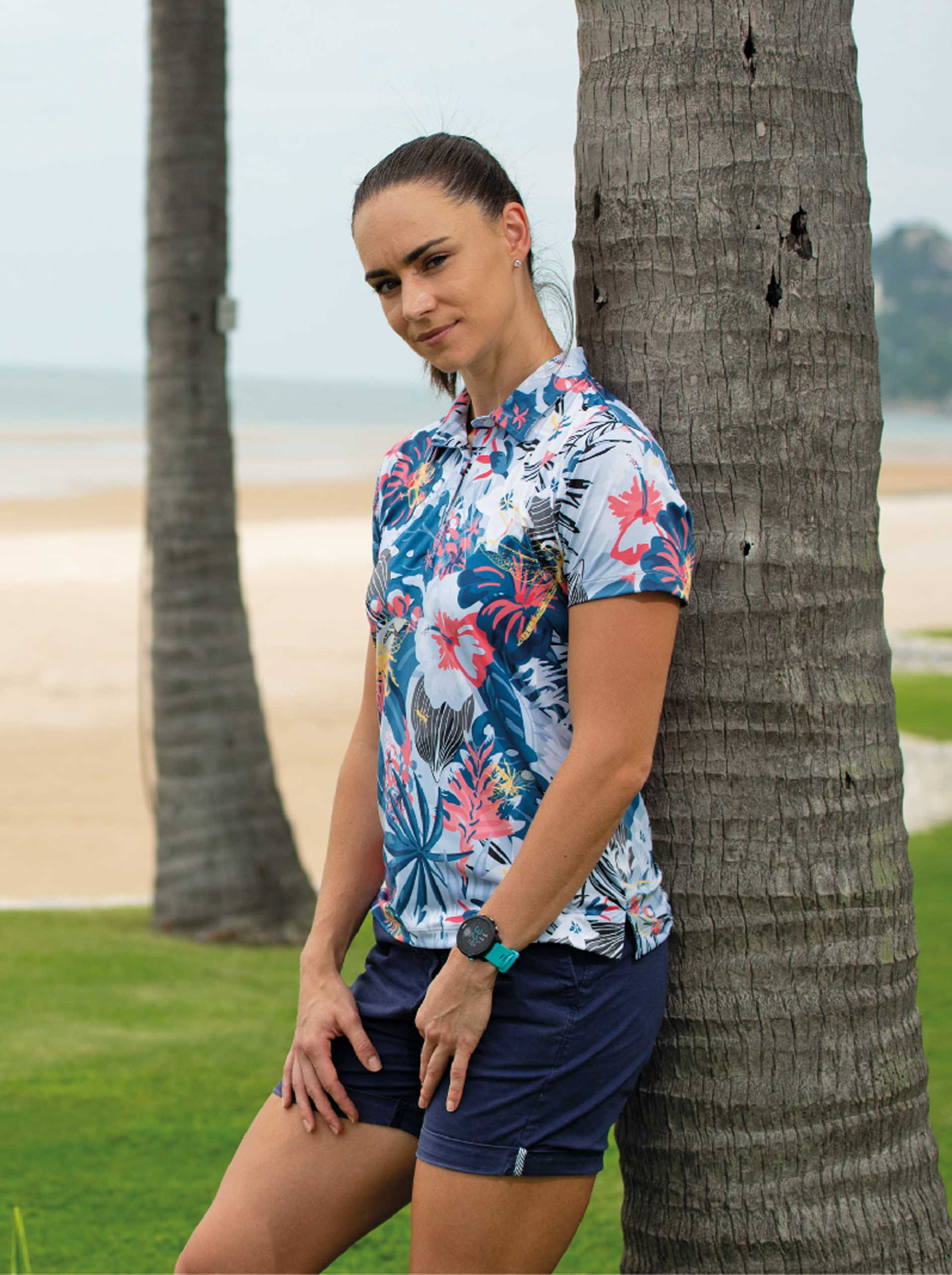 lady wearing a ladies tropical golf polo shirt