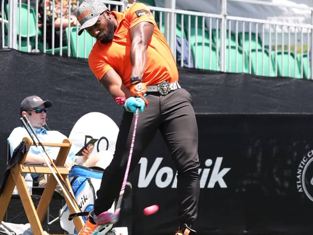 Golf professional smashing a driver from off the tee box